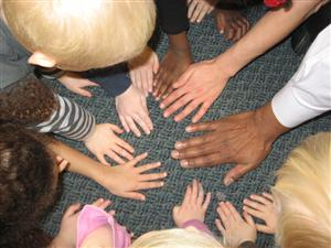 Many hands of different skin tones